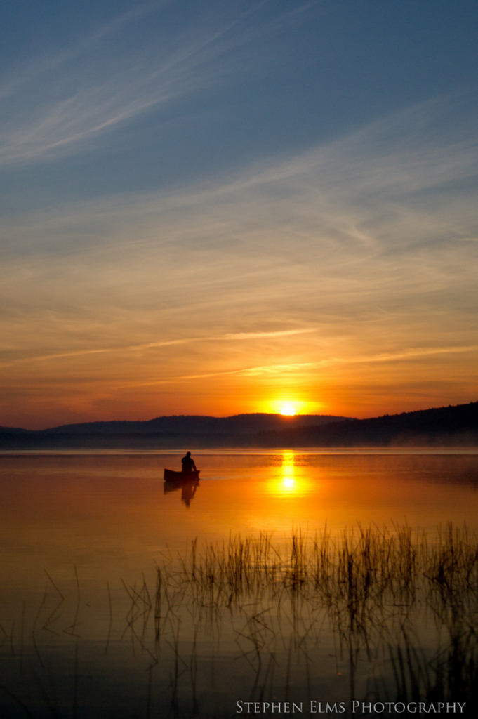 An early morning paddler on Lake of Two Rivers, Algonquin Park