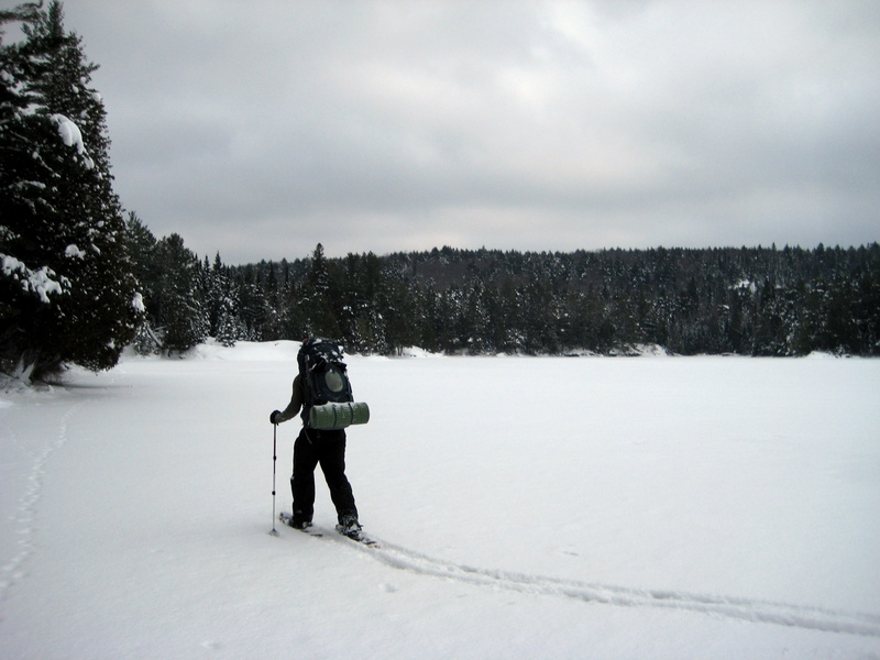 snowshoeing over frozen lake - algonquin