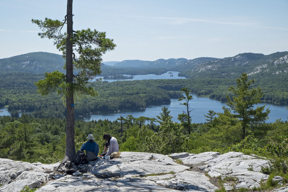 Hikers resting atop Crack Trail, Killarney Provincial Park