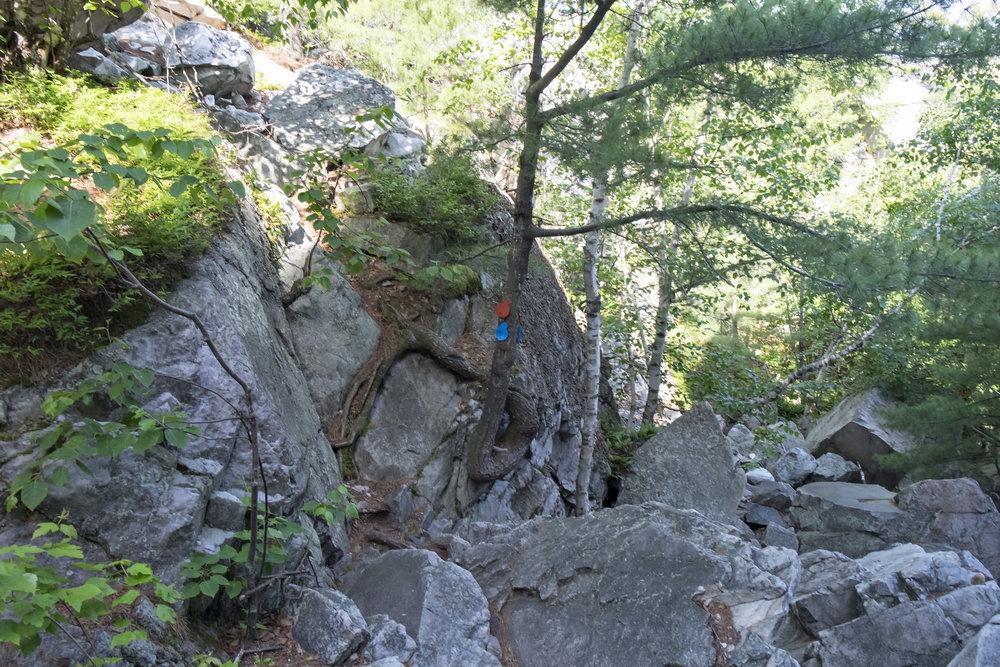 Navigating through large rocks along the Crack Trail
