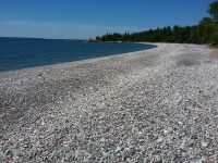 The cobble stone beach at halfway point of Orphan Lake trail loop (8km).