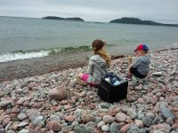 Snack break on the cobble stone beach at Gargantua Bay